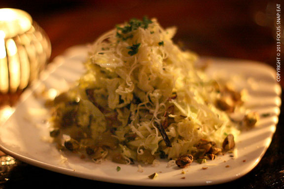 Ensalada de Col ($11.5) with savoy cabbage, green olives and pistachios topped with a mountain of Mahon cheese shavings. The dressing was creamy but light with anchovy flavors.