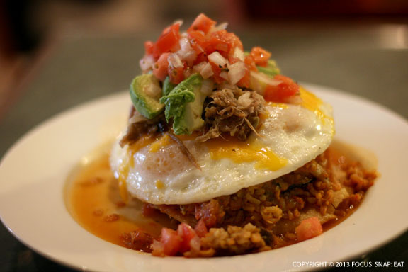 Kalua Huevos Rancheros ($11) was a layering of kalua pig, crispy tortilla, kimchi fried brown rice, avocado, and tomato and red bell pepper salsa with an over-easy egg.