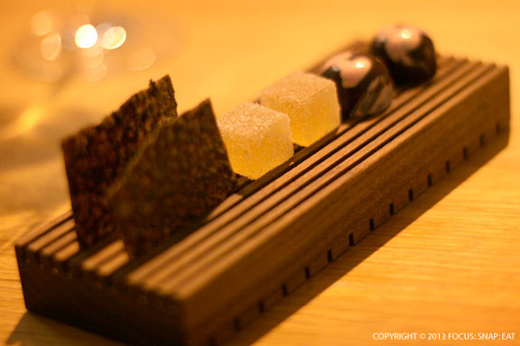 Mignardise of coffee brittle, whiskey sour gelee, bonbons are lovely conclusion to a refined meal