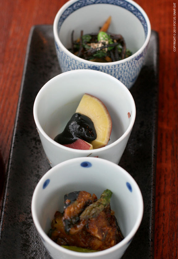 Obanzai ($12) is Kyoto-style cooked vegetables served three ways: hijiki (top), mountain yam with black sesame (center) and eggplant with spicy miso sauce.