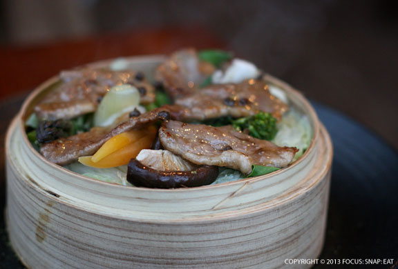 Sauteed Liberty duck breast served in a steamer filled of market vegetables ($16)
