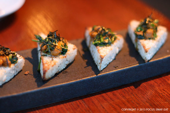 Yaki omusubi is grilled rice ball with uni and watercress soy butter sauce ($13)