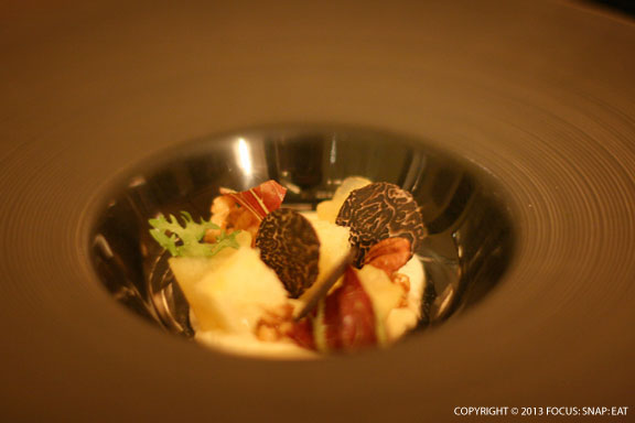 Sophisticated cheese course of brillat and apple, wild pecan, truffle