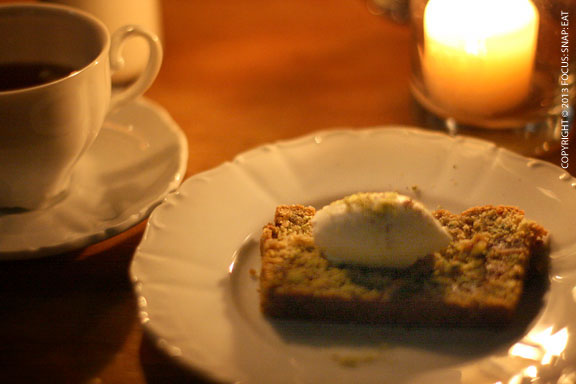 Fourth course: artichoke and pistachio bread with dates, black cardamon and creme fraiche. Paired with a Cynar tea with creme de violette and artichoke tisane.