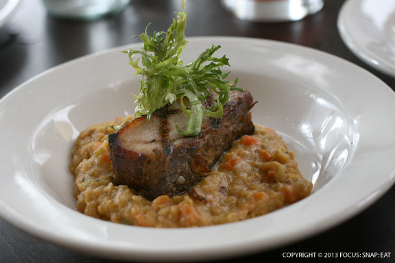 Pork belly served with red lentils mirepoix, $12