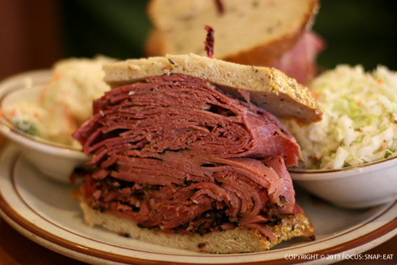 """The """"Freeser"""" ($15.50), corned beef and pastrami, served up with both cole slaw and potato salad."""