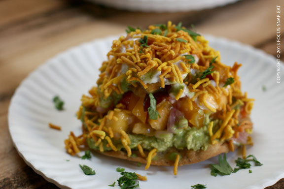 Sev puri ($6) is a puri cracker topped with green garbanzo bean paste and nectarines
