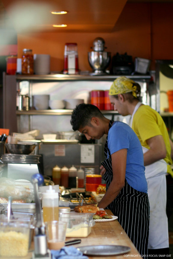Chef Preeti Mistry working behind the counter in the open kitchen at her new restaurant Juhu Beach Club