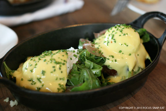 M.B. Post's benidict with bacon cheddar biscuits, arugula, la quercia tamworth prosciutto, and hollandaise sauce ($13)