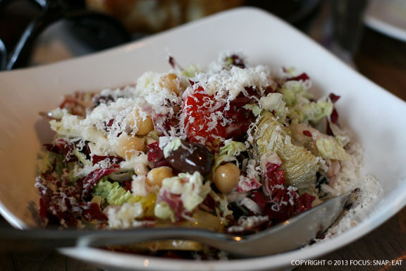 Chopped salad with baby artichokes, garbonzo beans, cherry tomatoes, Kalamata olives, peppadew, and parmesan cheese ($12)