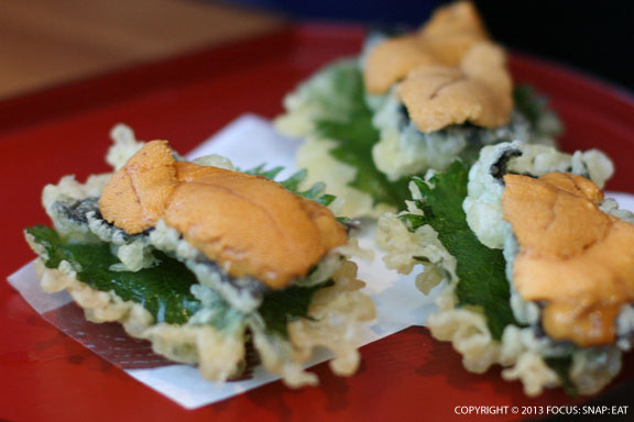 Special of uni tempura, fried vegetables topped with the fresh sea urchin