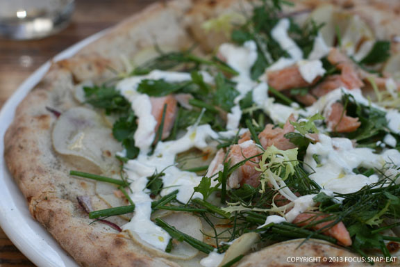 """""""Potato"""" pizza ($17) with smoked trout, herb salad and horseradish cream"""
