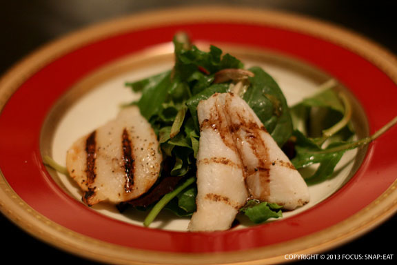 Grilled scallop and fish on a simple green salad was the least impressive dish of the night.