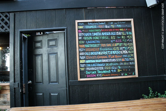 The colorful chalkboard with the day's selection of beer (by pint or pitcher)