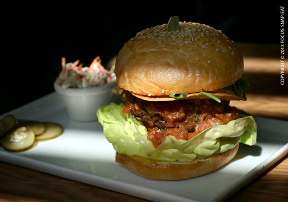 Chips n' Salsa burger ($9.5), with tortilla chips, jalapenos, roasted tomato salsa, nacho cheese and butter lettuce.