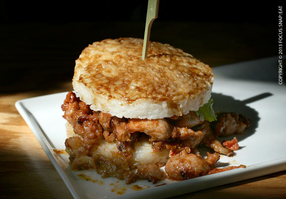 K-Pork ($8.75), spicy sliced Korean-style pork served with kimchi on a rice patty bun.