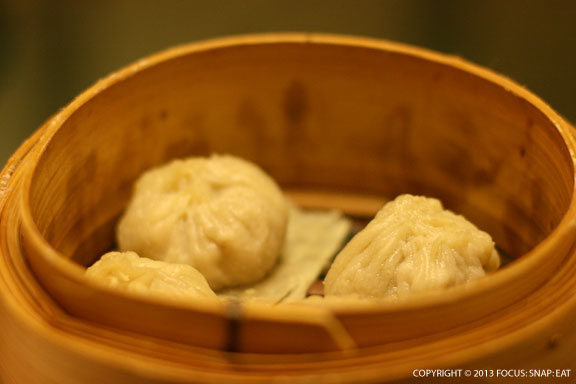 Soup dumplings didn't have the typical shape, coming out round with a big ground pork filling.