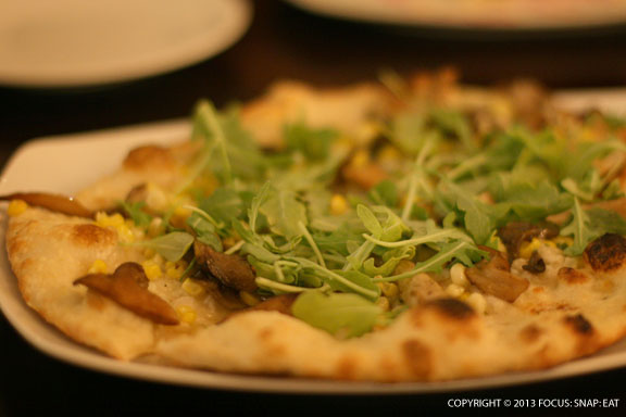 Corn and mushroom flatbread ($12/$5 during happy hour) with garlic butter, Jack cheese, and arugula (this was our favorite of the two flatbreads we tried).