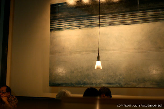 Contemporary artwork at 12th Avenue Grill gives the room a sophisticated vibe