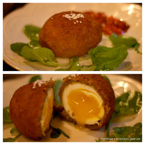 The signature duck duck scotch egg ($14) is a duck egg oozing out from its deep-fried shell and served with stonefruit chutney and spicy greens.