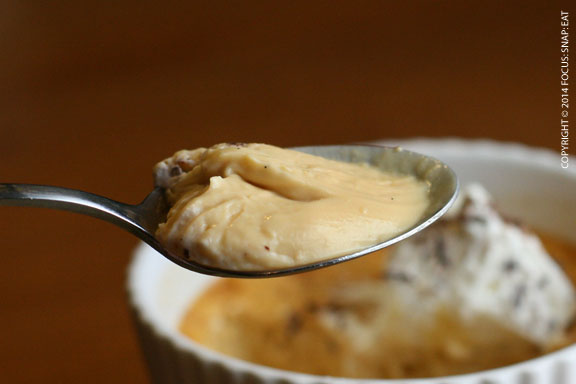 A spoon of the creamy pudding