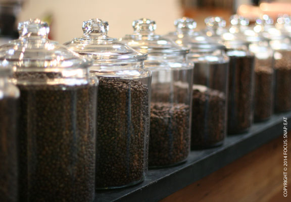 Coffee beans stores in large glass jars