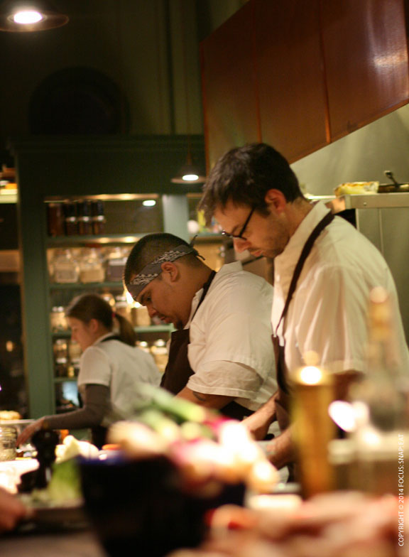 """Chefs working along the long open kitchen counter. I got a side view from the """"chef's counter."""""""