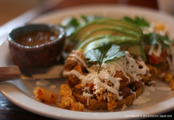 Sopes de Chorizo y Huevo, three masa boats, chorizo, scrambled egg, potato, bean, crema fresca, cotija cheese, avocado and casera salsa ($12)