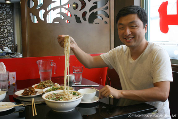 Rui serving up some noodles at Shancheng Hotpot King in Sydney