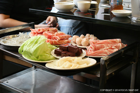 A table next to us prepares to do the hot pot with an assortment of ingredients