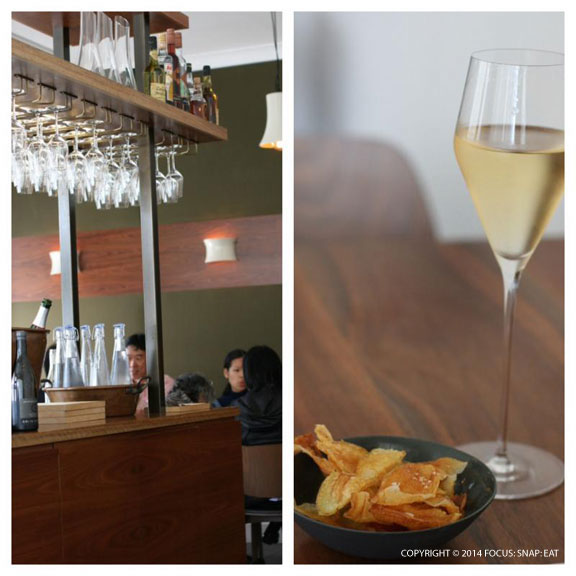 The simple, contemporary decor of Sixpenny. On the right, a small plate of home-made potato chips are brought out, and I started with a glass of sparkling wine.