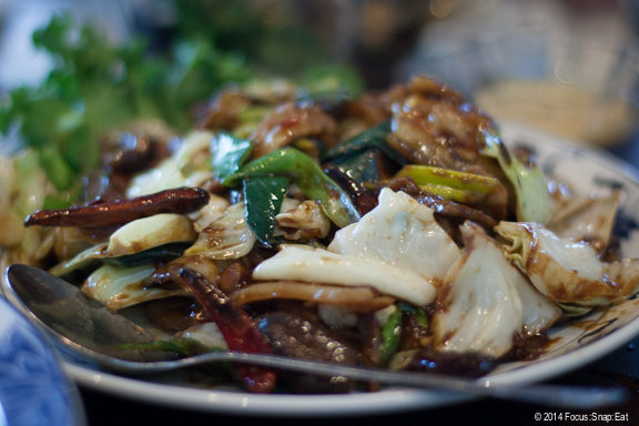 Twice-cooked pork ($9.95) is actually two types of pork (belly and shoulder) stir-fried with a pungent paste and cabbage and mushrooms and chili peppers