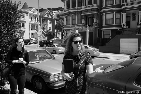"""Virginia Miller gave some history of the area to start the tour, which began in front of the neighborhood's """"painted ladies."""""""