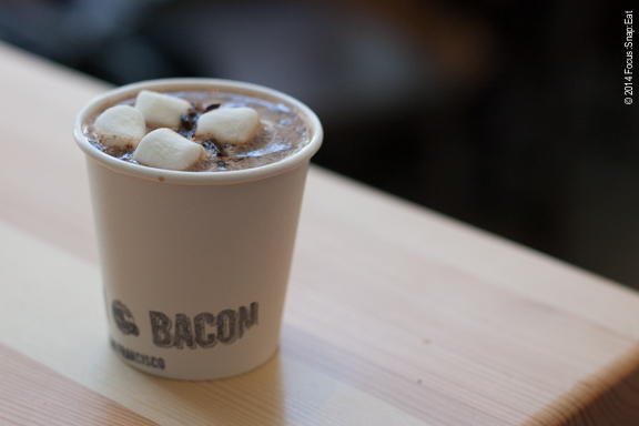 Mexican hot chocolate with bits of bacon sprinkled on top.