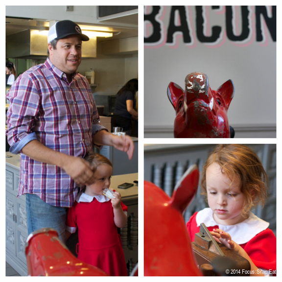 Bacon Bacon owner Jim Angelus spoke to the tour while his daughter distracted us in her pretty red dress.
