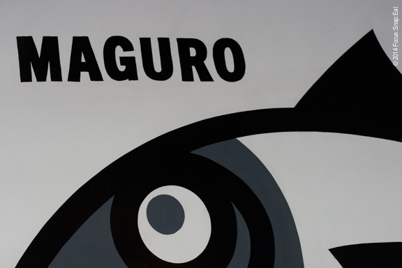 Part of the graphic mural on the wall at the entrance of Ichi provides a look at sushi and how it should be eaten.