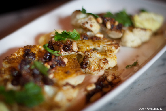 Cauliflower steaks with curry, brown butter puree, currants and pine nuts, $7