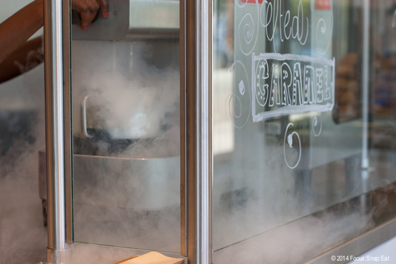"""Ice cream being churned with liquid nitrogen. It actually isn't """"instant"""" because it's roughly a 3- to 5-minute wait, depending on the crowds."""