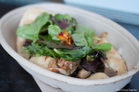 I tried a fennel sausage flatbread with fresh greens and caramelized onions. It was tasty but a bit hard to eat.