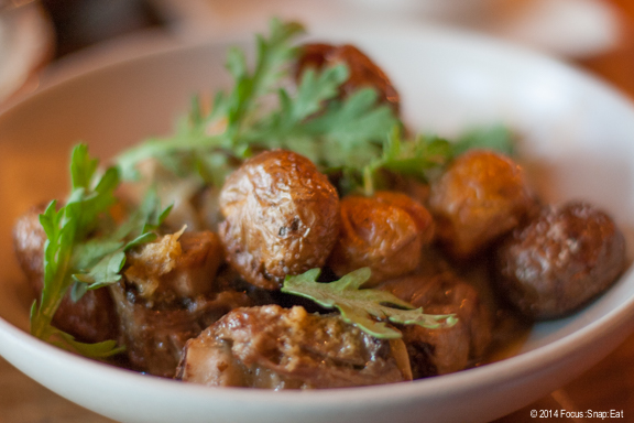 Braised oxtail can barely be seen under a pile of perfectly cooked potatoes. $17