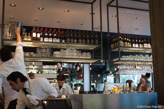 The bar in the center of the restaurant serves as a raw bar as well as serving up drinks.