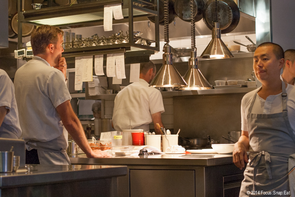 The open kitchen. Chef Jason Berthold (back toward picture) is on the far left and that's Chef/Owner Corey Lee on the far right.