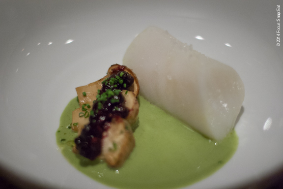 Third course of mero sea bass with matsutake mushroom, huckleberry-ginger agro dolce, in a padron pepper nage sauce.