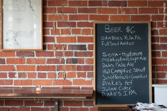 Red-brick wall of Townie and some of the beer offerings.