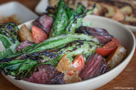 Grilled Caesar salad ($9) with heirloom tomatoes, and grilled hanger steak (added for an additional $5)