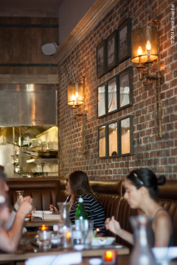 The main dining area is surrounded by brick wall motif.