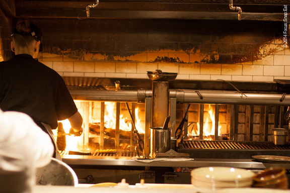 The wood fire oven is the centerpiece of Fog City's open kitchen.