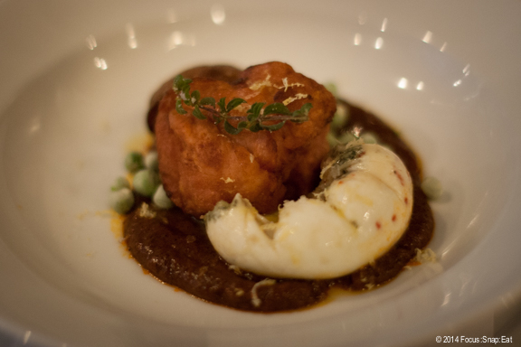 Crispy sweetbread with potatoes, bravas sauce, and olive oil poached egg ($16)