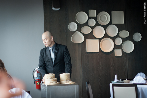 A server pushes the dim sum carts. You can only order from the carts, so with the limited menu you sometimes see the same things circle before something new comes along.