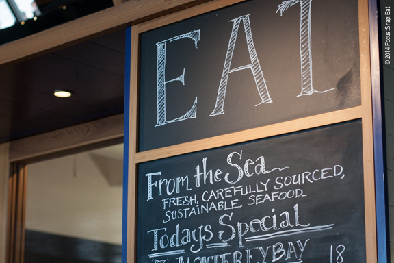 A chalkboard displays the daily specials, often local seafood dishes.